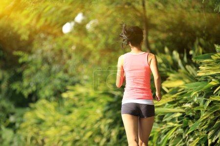 Asian woman jogging
