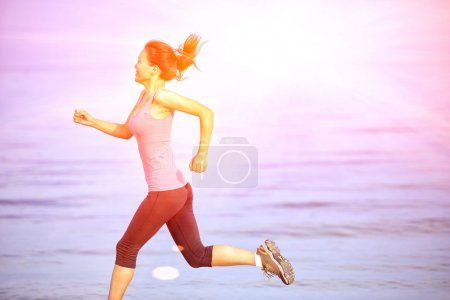 Photo for Sports woman running seaside beach - Royalty Free Image