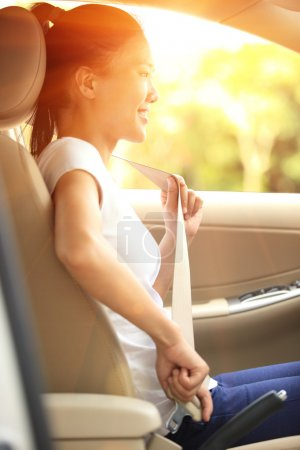 Photo for Woman driver buckle up the seat belt before driving car - Royalty Free Image