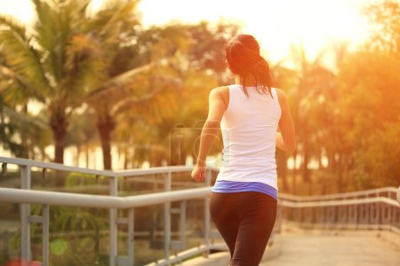Photo for Healthy asian woman runner running outdoor under sunrise - Royalty Free Image
