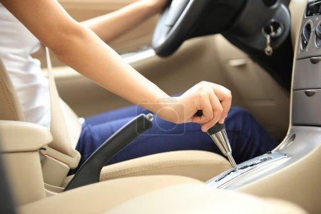 Driver shifting gear stick