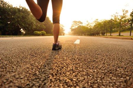 Woman running at sunrise