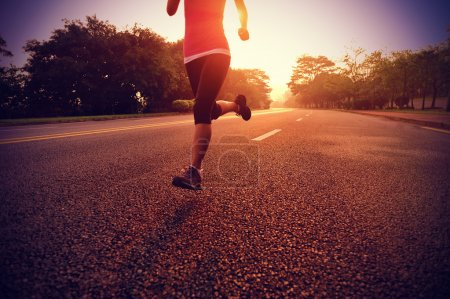 Photo for Runner athlete running at road. woman fitness sunrise jogging workout wellness concept. - Royalty Free Image