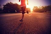Runner athlete running at road