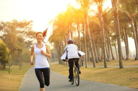 Runner athlete running at tropical park.