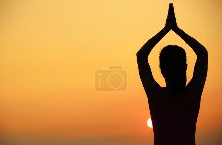 Photo for Healthy fitness yoga woman meditation at sunrise seaside - Royalty Free Image