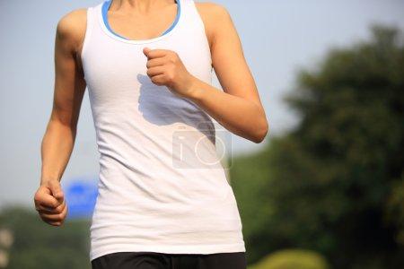 Runner athlete running at tropical park