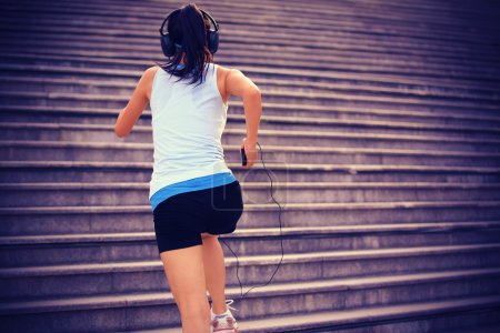 Runner athlete running on stairs.