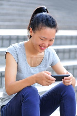Young asian woman use her smart phone