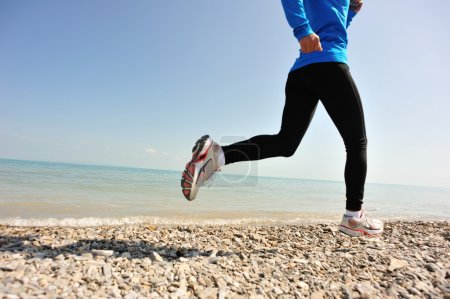 Photo for Fitness woman running on seaside - Royalty Free Image