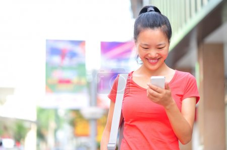 Young asian woman using her smart phone