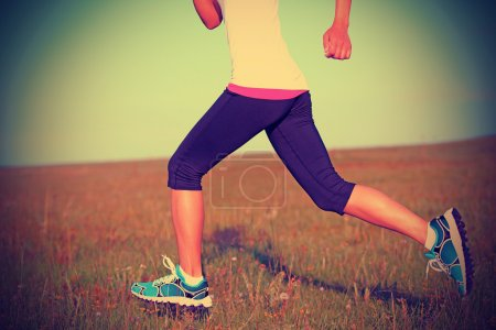 Runner athlete running on grass seaside.