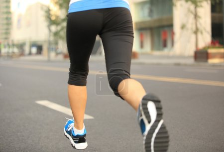 Photo for Runner athlete running on city street. woman fitness jogging workout wellness concept. - Royalty Free Image
