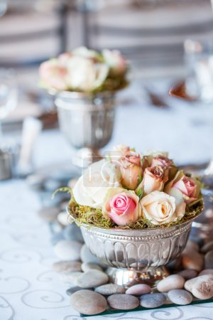 Beautiful bouquet of roses at wedding reception