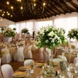 Indoors wedding reception venue with decor, select...
