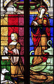 The stained glass window of Margarete and St Margaret Of Antioch at Brou church in Bourg-en-Bresse