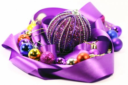 Purple ribbon and colorful balloons