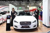 BANGKOK - August 19: Jaguar XJ car with unidentified models on d