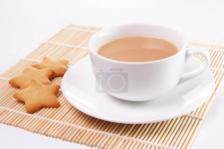 Cup of tea with milk and star shaped biscuits...