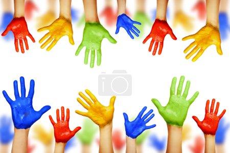 Photo pour Mains colorées isolés sur blanc - image libre de droit
