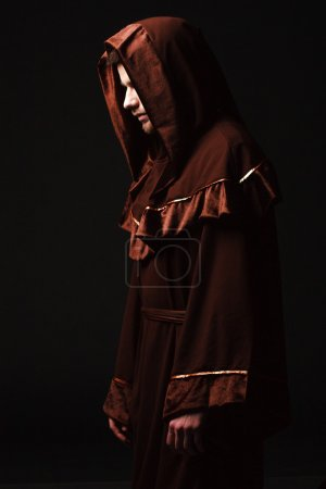 Mysterious Catholic monk. studio shot