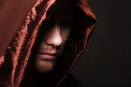 Portrait of mystery unrecognizable monk in robe...
