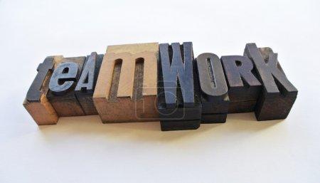 Woodtype letters teamwork