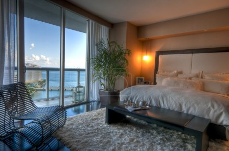 Photo for View of luxury apartment bedroom with view to the bay. - Royalty Free Image