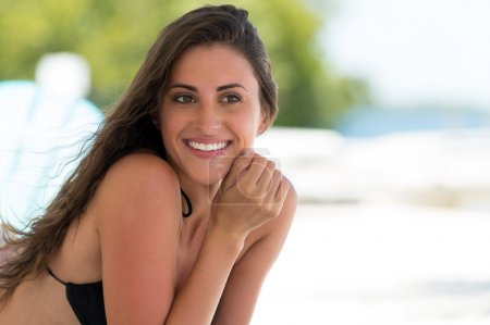 Beautiful smiling woman in a tropical beach