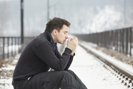 Photo for Sad man in railroad track - Royalty Free Image