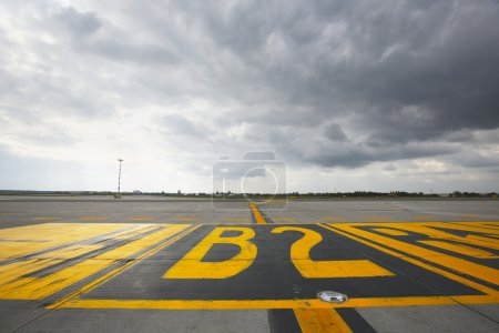 Photo for Airfield - marking on taxiway is heading to runway. - Royalty Free Image