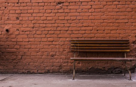 Red brick wall and bench