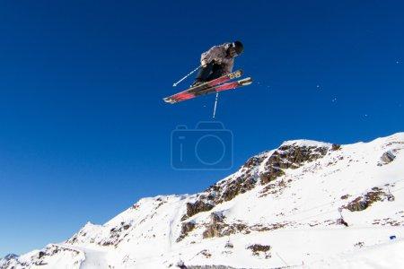 Skier performing jump at ski resort. Trademarks ha...