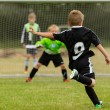 Goalkeeper and penalty kicker in the midst of a pe...