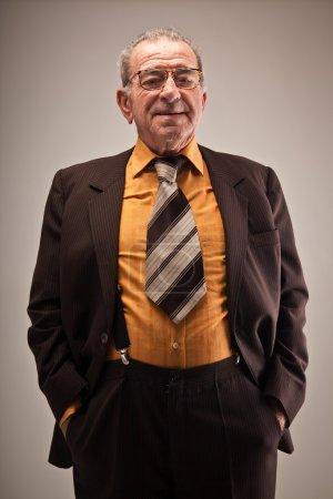 Portrait of old man in suit