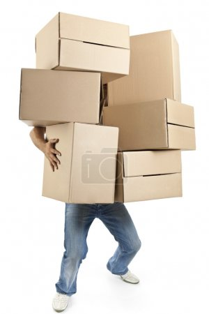 Photo for Young man carrying and dropping his stack of moving boxes - Royalty Free Image