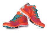 Nové běžecké boty, tenisky nebo trenér izolovaných na bílém