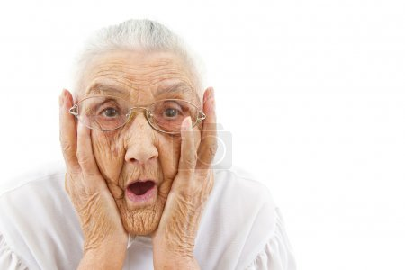 Photo for Portrait of a surprised old woman who is staring with open mouth - Royalty Free Image