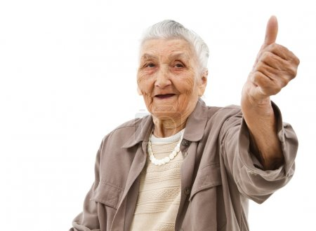 Photo for Old lady showing thumbs up in front of an isolated background - Royalty Free Image