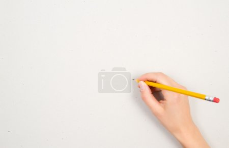 Photo for A woman's hand is preparing for drawing with a pencil on a white sheet of paper - Royalty Free Image