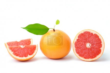 Photo for Ripe grapefruit with leaves and slices on white - Royalty Free Image
