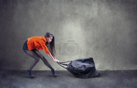 woman carrying heavy bag