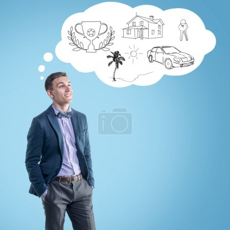 Young man planning his future and dreaming mortgage credit house car recreation vacation travel