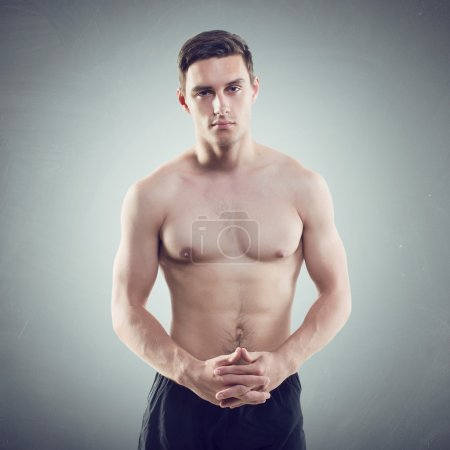 Photo for Portrait of Portrait of an attractive athlete sportsman muscular handsome sexy guy in sport dress, strong man, naked torsoan attractive athlete sportsman muscular handsome sexy guy in sport dress, strong man, naked torso - Royalty Free Image