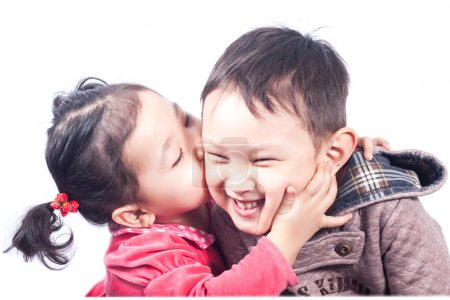 little girle kissing a boy