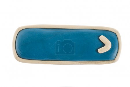 Photo pour Bouton avec une flèche en plasticine sur fond blanc - image libre de droit