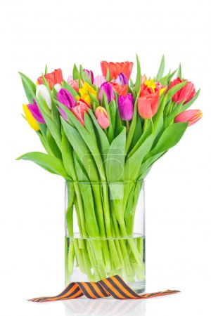 Photo for Tulips in the vase and a ribbon on white background - Royalty Free Image