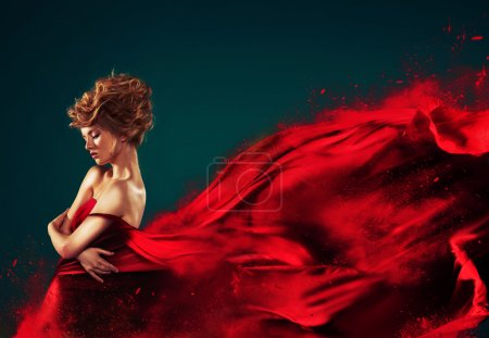 Photo for Woman in red blowing flying red dress dissolving in splash - Royalty Free Image