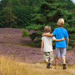 Kids walking on moor land...