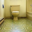 Bathroom designed in hideous green and yellow 70s style in desperate need of a makeover and updates.